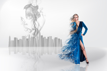 dispersion: Beauty blonde on the fog in grey background Stock Photo