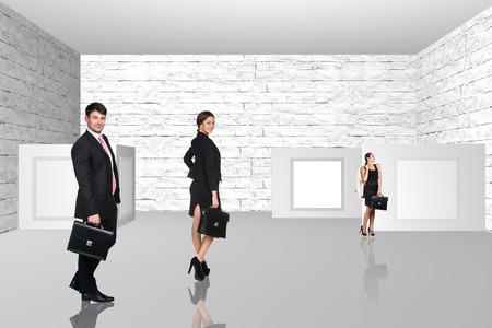Business people walking on art gallery on light background Stock Photo