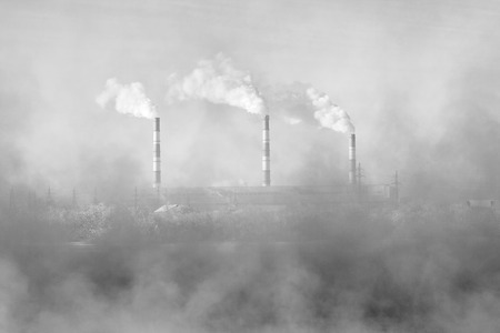 polluting: Factory pipes polluting air, environmental problems