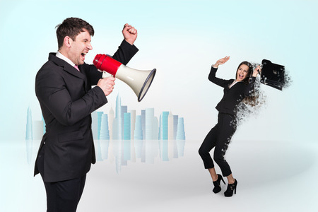 assertion: Chief shouting through megaphone on the  businesswoman on light background Stock Photo
