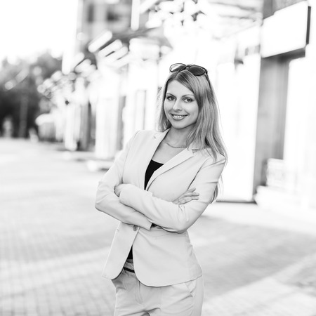 portrait of an executive young woman posing outdoors photo