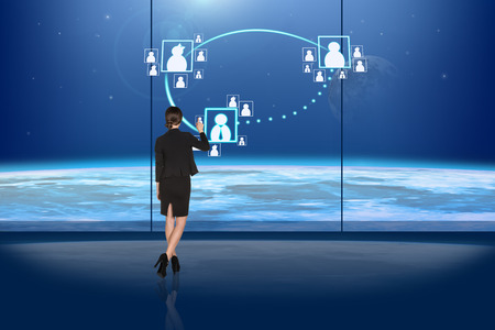 busineswoman: Rear view of busineswoman touching digital screen
