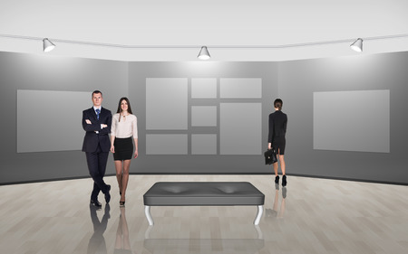 Business people walking on gallery art on grey background photo
