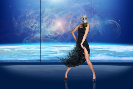gasmask: Girl in a gas-mask is dancing on globe background