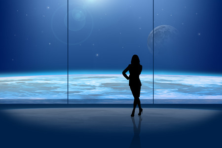 lonelyness: Businesslady in front of the window at night Stock Photo