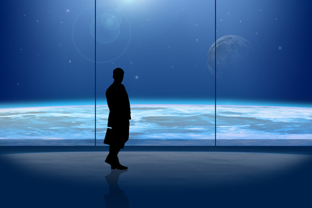 lonelyness: Businessman in front of the window at night Stock Photo