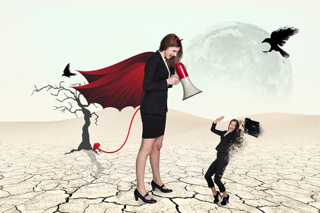businesslady: Devil businesslady with a megaphone screeming at another businesslady in a desert