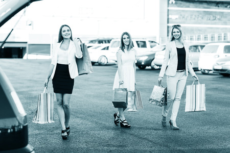 shopping centre: Three women were shopping in a mall or shopping centre and driving home now with their car Stock Photo