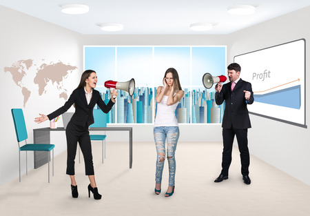 Business consultant with megaphone standing at office photo