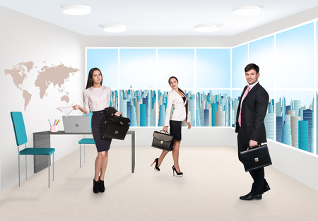Group of business consultants standing at office photo