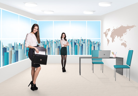 Beautiful businesswomen consultants standing at the office photo