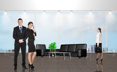 large windows: Younge people in the modern office with large windows
