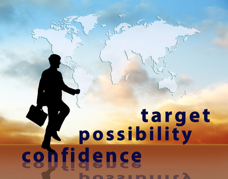 work worker workforce world: Image of confident businessman with briefcase walking up to target.
