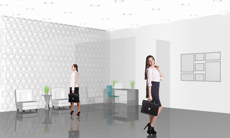 Beautiful businesswoman consultants standing at the office photo