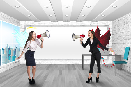 Angel and Deval shouting in megaphones. Office photo