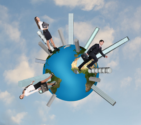 People walk on the globe among skyscraper.   photo