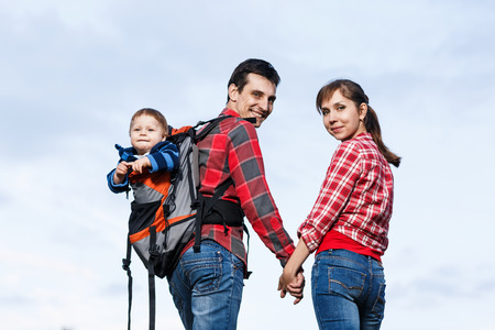Baby boy in backpack carrier on walking tour. photo