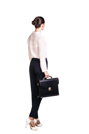 Full length portrait of business woman with briefcase. rear view Stock Photo