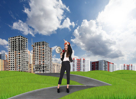 buiseness: Businesslady in front of the new buildings Stock Photo