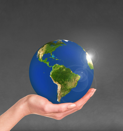 civilisation: Planet earth in a human hand isolated