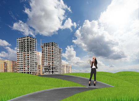 businesslady: Businesslady in front of the new buildings Stock Photo