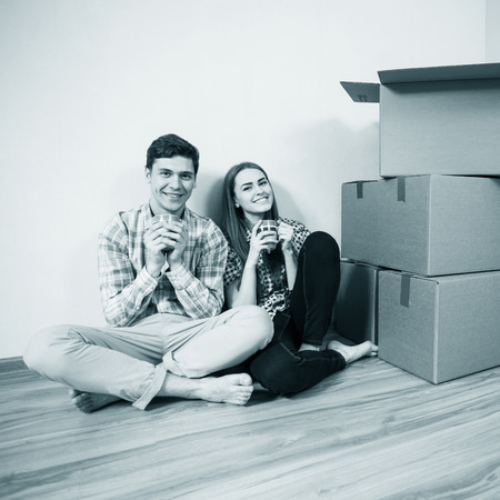 RELOCATED: Relocated couple drinking tea on the floor