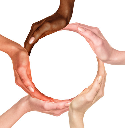 dark skinned: Conceptual symbol of multiracial human hands making a circle on white background with a copy space in the middle