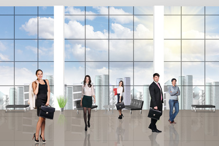 large windows: Young team in the modern office with large windows