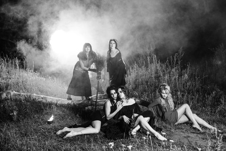 coven: Whitches coven. Dark night. Fire on background