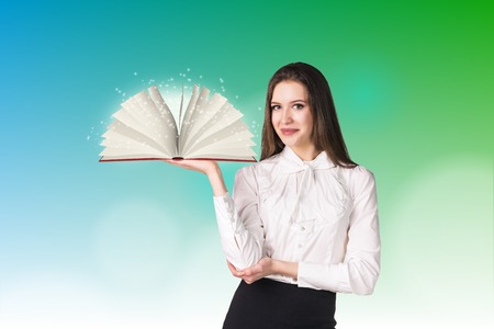 Businesswoman with a book on blured background Stock Photo