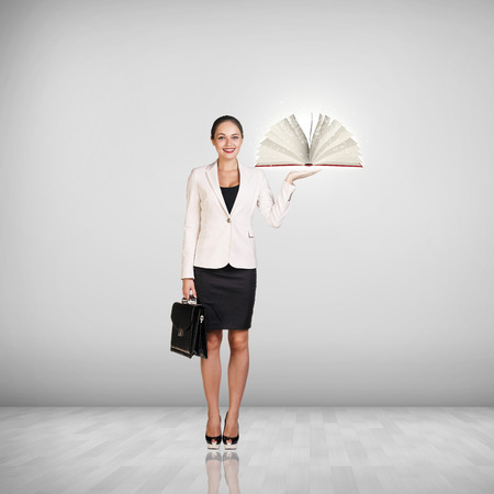 Businesswoman with a book and briefcase