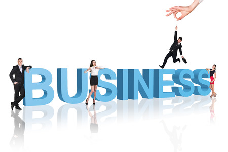 Business - professionals  in business clothes walk close to text.