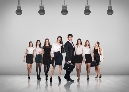 teamworking: Business people and team on gray wall background Stock Photo