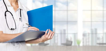 Closeup photo of doctor with folder on urban background