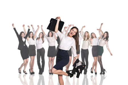study group: Businesswoman on the background of smiling happy businesswomen Stock Photo