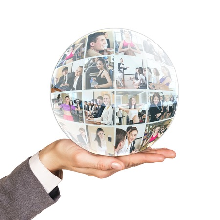 mixed age range: Hand holds collage of diverse business people in sphere over white background