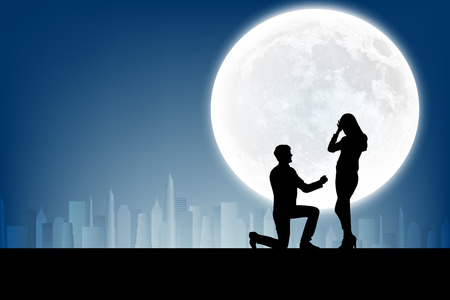 man in the moon: silhouette of man makes a proposal a silhouette woman on the full moon background