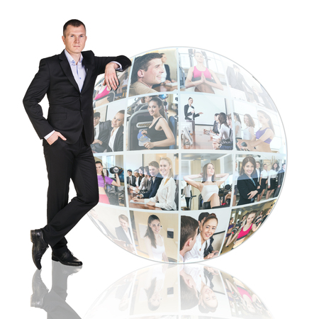 mixed age range: Man stands beside collage of diverse business people in sphere over white background