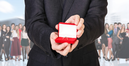 winning proposal: Business man stands foreground on the blurred crowd over white background