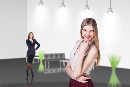 go inside: Several business people stand in the office hall