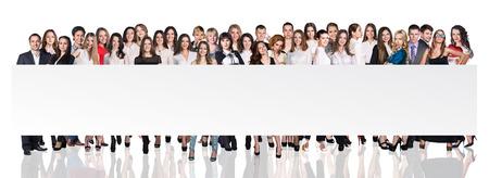 Groep zakenlieden die lege banner over witte achtergronden presenteren Stockfoto