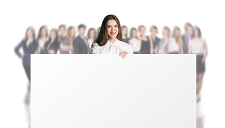 Businesswoman holding a big placard on the blurred people background. Over white background.