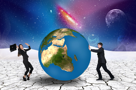 pushes: Businessman pushes world sphere in cosmos desert .Elements of this image furnished by NASA Stock Photo