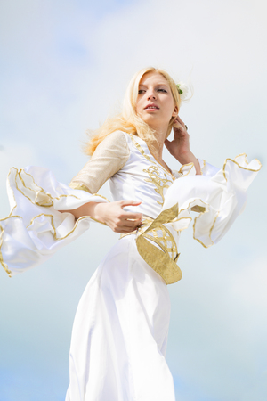 medieval dress: Young woman runs in the white medieval dress