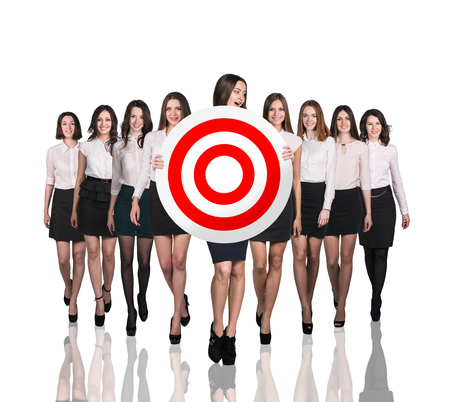 circulo de personas: Business woman smiling and holding big target . Success concept portrait.