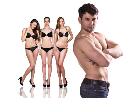 sexy young girls: Full length portrait of a beautiful brunette women in black bikini and man with muscle isolated on white background Stock Photo