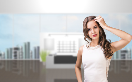 go inside: Business woman stand alone in office reception Stock Photo