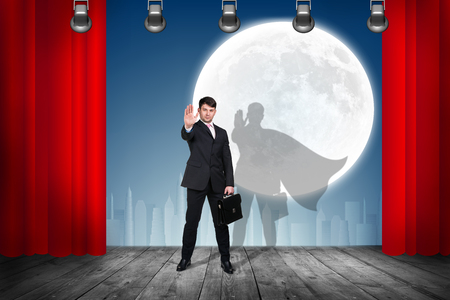 stage props: Businessman stands on the scene with curtains over night city background
