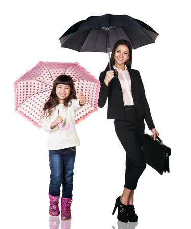 baby isolated: Businesswoman with daughter under umbrellas on the white background
