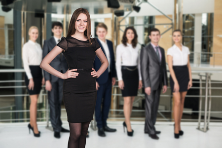 Group of business people  stand in a modern office hall Zdjęcie Seryjne
